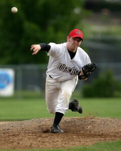 baseball pitcher with open stride and good pitching velocity