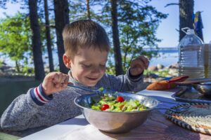 youth pitching player eating nutritious salad